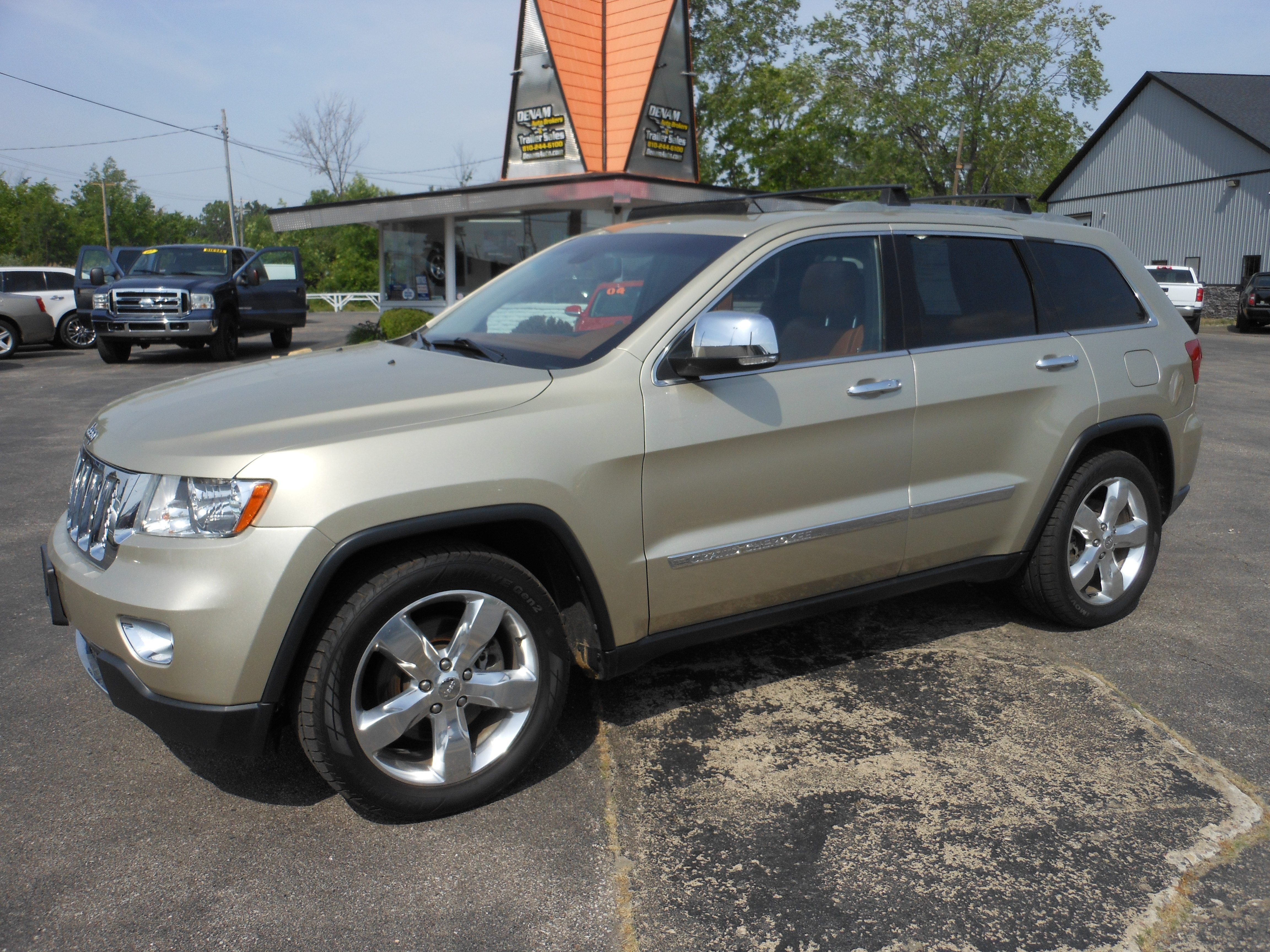 2011 Jeep Grand Cherokee Overland Summit Gold 1 Denam Auto Trailer Sales