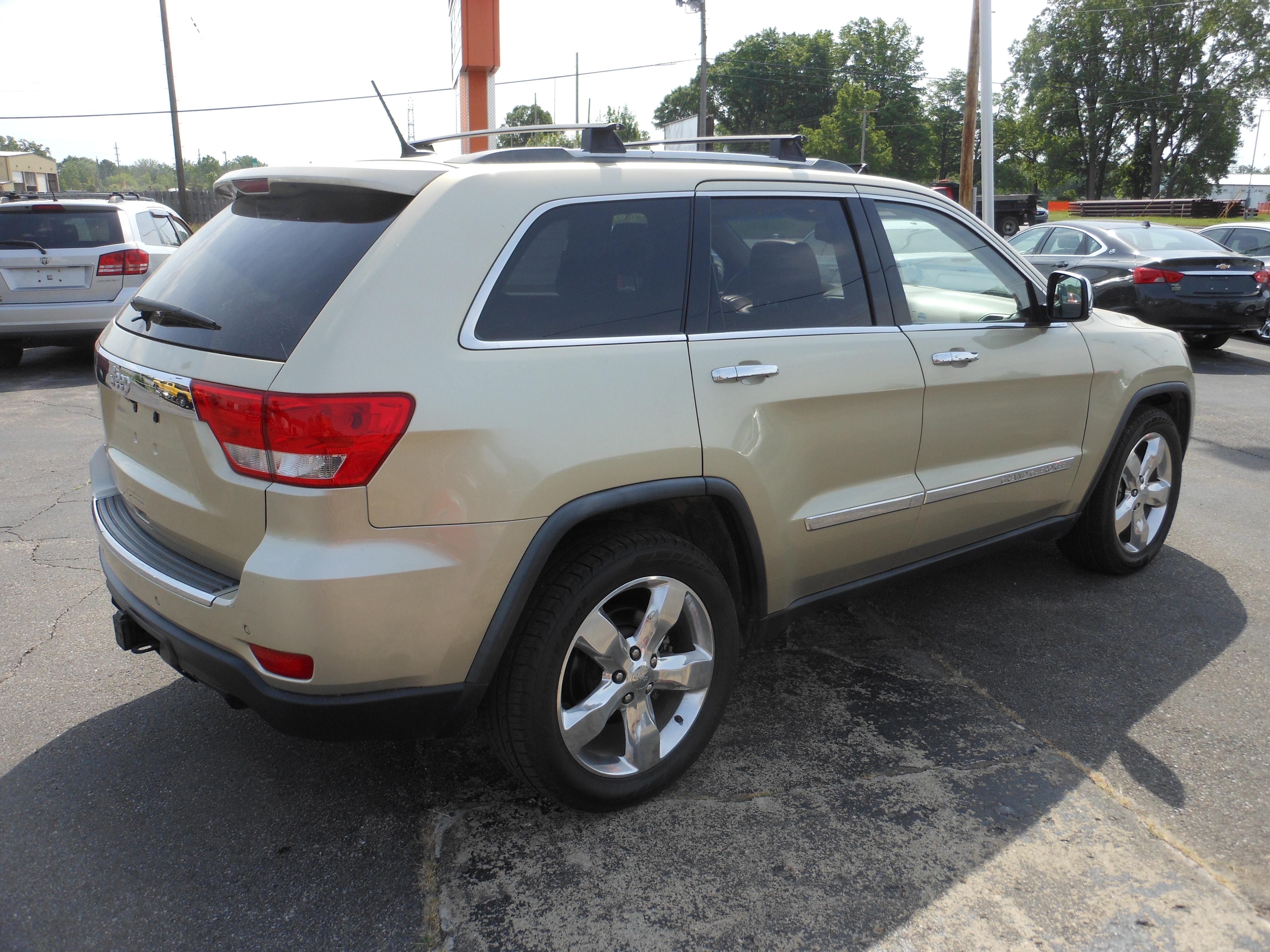 2011 Jeep Grand Cherokee Overland Summit Gold 6 Denam Auto Trailer Sales